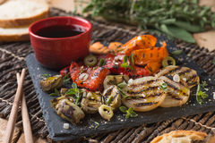 Organic grilled vegetables. Grilled seasonal vegetables dressed with herbs, balsamic winegar and olive oil Stock Photography