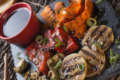 Organic grilled vegetables. Grilled seasonal vegetables dressed with herbs, balsamic winegar and olive oil Stock Photos
