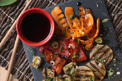 Organic grilled vegetables. Grilled seasonal vegetables dressed with herbs, balsamic winegar and olive oil Royalty Free Stock Photography