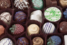 Organic hand crafted chocolate. S with beautiful designs stock photos