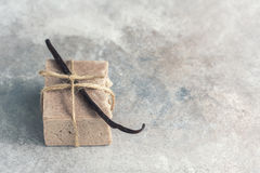 Organic handmade soap with vanilla on a concrete background, spa concept. Royalty Free Stock Photos