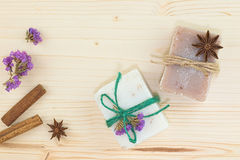Organic handmade soaps decoration by spices cinnamon, star anise and dry flowers on wood board Stock Photo