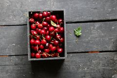 Organic or healthy food idea. Ripe cherries on a on rustic wooden background, Royalty Free Stock Photo