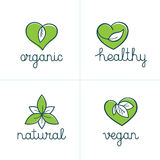 Organic, healthy and vegan badges - emblems for vegetarian food. Vector set of logo design templates and badges in trendy linear style with green leaves Stock Photography