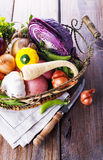 Organic healthy vegetables in the rustic basket Stock Image