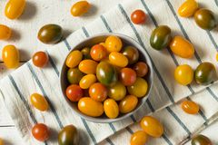 Organic Heirloom Cherry Tomatoes. In a Bowl stock images