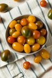 Organic Heirloom Cherry Tomatoes. In a Bowl royalty free stock photos