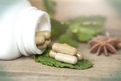 Organic Herb capsule Stock Photo