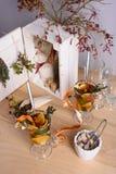 Organic herbal tea mix with lemon, orange, cinnamon, thyme and cane sugar on wooden table. Stock Image