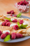 Organic home made Crepes with cream and raspberry stock photography