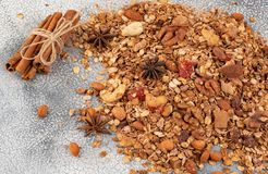 Organic homemade Granola Cereal with oats, almond, anise and cinnamon. Texture oatmeal granola or muesli as background. Top view. Or flat-lay. Copy space for royalty free stock images