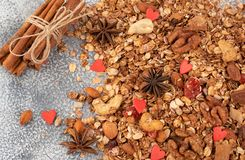 Organic homemade Granola Cereal with oats, almond, anise and cinnamon. Texture oatmeal granola or muesli as background. Top view. Or flat-lay. Copy space for stock photo