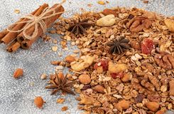 Organic homemade Granola Cereal with oats, almond, anise and cinnamon. Texture oatmeal granola or muesli as background. Top view. Or flat-lay. Copy space for royalty free stock photo