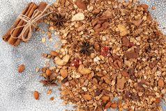 Organic homemade Granola Cereal with oats, almond, anise and cinnamon. Texture oatmeal granola or muesli as background. Top view. Or flat-lay. Copy space for stock photos