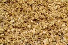Organic homemade Granola Cereal with oats and almond. Texture oatmeal granola or muesli as background. Top view or flat-lay. Copy. Space for text royalty free stock image