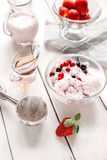 Organic homemade ice cream in glass bowl on wooden background. Organic homemade ice cream with strawberry in glass bowl on wooden background Stock Image