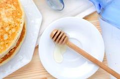 Organic honey and pancakes Stock Photos