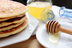 Organic honey and pancakes Royalty Free Stock Photo