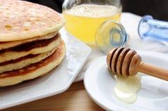 Organic honey and pancakes Royalty Free Stock Photo