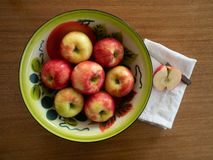 Organic Honeycrisp Apples in a Tin Bowl with a Half Apple and Pa stock photo