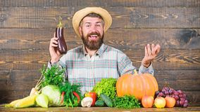 Organic horticulture concept. Grow organic crops. Homegrown organic food. Man with beard wooden background. Farmer with. Organic vegetables. Gardening and stock images