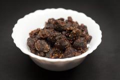 Organic Indian bdellium in ceramic bowl Royalty Free Stock Photography