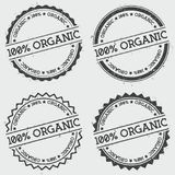 100% Organic insignia stamp isolated on white. 100% Organic insignia stamp isolated on white background. Grunge round hipster seal with text, ink texture and royalty free illustration