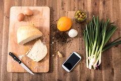 Organic Kitchen with Smartphone Royalty Free Stock Photos