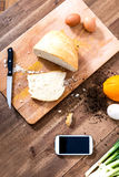 Organic Kitchen with Smartphone Royalty Free Stock Photography
