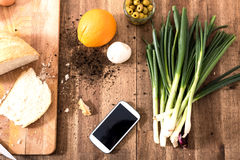 Organic Kitchen with Smartphone Royalty Free Stock Image