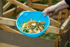 Organic kitchen waste gathered for composting. In the garden. Natural gardening, waste sorting, food wasting concept Royalty Free Stock Photography