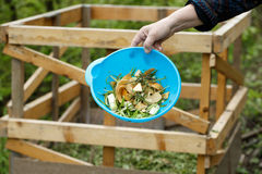 Organic kitchen waste gathered for composting. In the garden. Natural gardening, waste sorting, food wasting concept Stock Photography