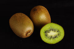Organic kiwi fruit  on the black background Stock Photos