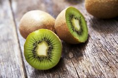 Organic Kiwis on Wood Stock Images