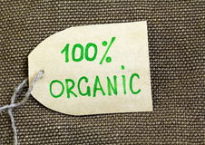 Organic label on the  burlap background Royalty Free Stock Images