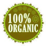 100% organic label. 100 percent organic badge on white background with leaves Royalty Free Stock Photos