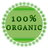100% organic label. 100 percent organic badge on white background with leaves stock illustration