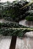 Organic Lacinato Kale brown table Royalty Free Stock Photos