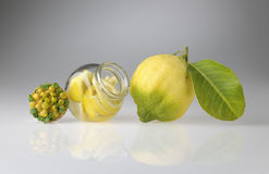 Organic lemon of Sorrento with macerated pieces under glass. Organic lemon of Sorrento with glass jar Royalty Free Stock Images