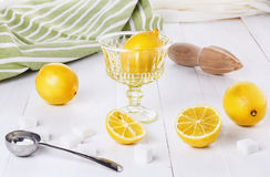 Organic lemons over white wooden background Royalty Free Stock Photo