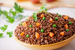 Organic Lentils With Carrots And Peas. Close up of some organic brown lentils stock photography