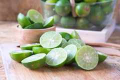 Organic lime on wooden table Royalty Free Stock Images