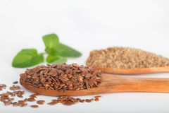 Organic linseeds and ground flaxseeds Royalty Free Stock Image