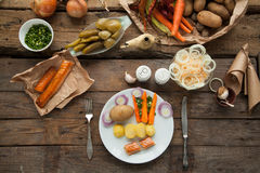 Organic lunch with smoked salmon and boiled potato. Royalty Free Stock Image