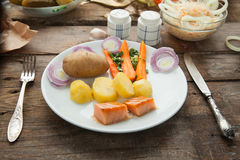 Organic lunch with smoked salmon and boiled potato. Royalty Free Stock Photo