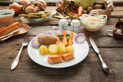 Organic lunch with smoked salmon and boiled potato. Stock Photos