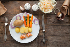 Organic lunch with smoked salmon and boiled potato. Royalty Free Stock Images