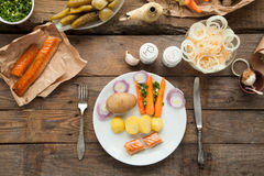 Organic lunch with smoked salmon and boiled potato. Royalty Free Stock Photos
