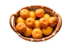 Organic mandarin in basket on a white background. Organic mandarin, tangerine citrus fruits in basket on a white background Royalty Free Stock Photo