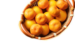 Organic mandarin in basket on a white background. Organic mandarin, tangerine citrus fruits in basket on a white background Royalty Free Stock Photography